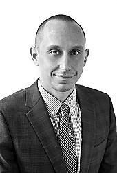 Black and white headshot of Frank Kolenko