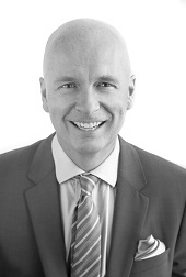 Black and white headshot of Kevin H. Griffiths