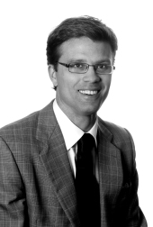 Black and white headshot of Kieran C. Dickson